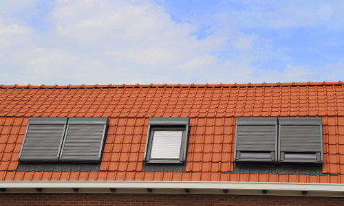 Close up on orange roof with white guttering